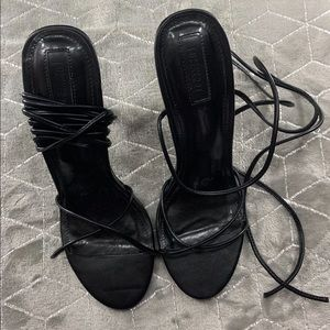 Black strappy heel that ties around ankles